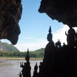 Profiles of Buddha Statues overlooking the Mekong