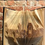 """Purple Onion"" written in book folding decor item."