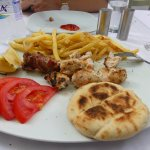 The chicken and beef skewers with chips and naan