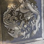Phoenix and dragon tile on a walkway