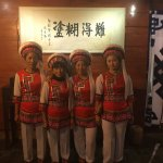 The staff dressed in traditional Bai clothing