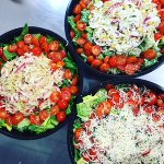 Catering salads out the door.