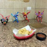 counter seating with figures from Dia de los Muertos