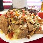 Huge platter of nachos with chicken.