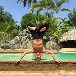 Simon Borg-Olivier Headstand by the pool at YogaMagic