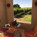 Sitting area overlooking Cavieres vineyards with an open air window