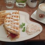 Waffle sandwich and cappucino.