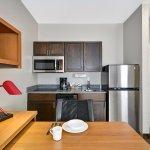 Queen Studio Suite Kitchen area, great for long term stays.