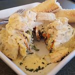 Lasagna Roll topped with chicken, stuffed with ricotta, spinach and alfredo sauce