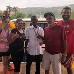 Our family with the BEST tour guide !!!!! Our Jamaican family !