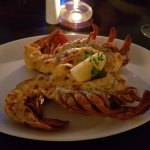 Lobster Thermidore, served with chips & mange tout