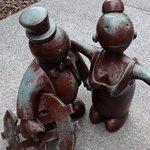 Brass people in the garden