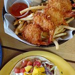 My husband ordered coconut shrimp and I ordered chicken tacos ... fries generous and good