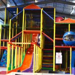 Fun for all ages! Indoor playground with 3 giant slides, ball pit, cargo netting, jumping castle