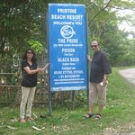 Me and My wife standing in the sign board of the resort