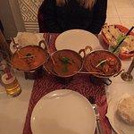 Butter chicken (left), lamb madras and chicken tikka masala