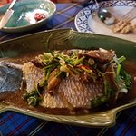 Steamed sea bass with ginger sauce