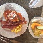 breakfast of banana pancakes, papaya, star fruit and local eggs