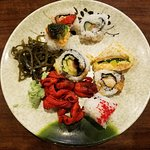 Sushi, Seaweed Salad, and Whole Baby Octopus