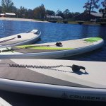 The fleet of paddle boards ready to be ridden at Lake Butler, Florida
