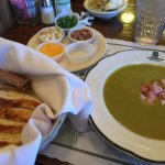 Pea soup with side of optional condiments.
