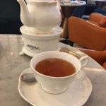 Hot tea serve with a tea pot.