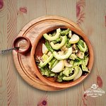 Green salad, avocado, apple dried fig and nuts