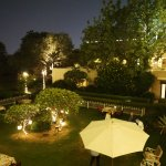 The garden at night, looking towards the terrace