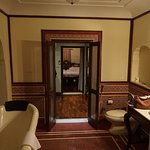 Bathroom, looking through the dressing/luggage room to the bedroom