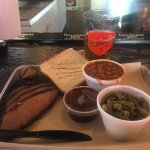 Delicious sliced brisket, green beans & barbecue beans with Texas toast and the BEST sauce