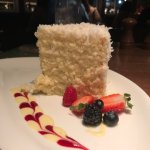 Coconut layer cake with wonderful layers of whipped cream. Didn't need it, wonderful!!