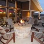Relax on our new outdoor fire pit area & utilize our BBQ grills on site