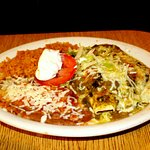 Enchiladas Suizas con arroz and frijoles refritos.