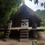 Traditional Vietnamese huts ( Men's stairs on the left)