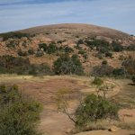 View of Enchanted Rock from the base at the gazebo. Guided hikes are led from the gazebo on week
