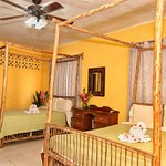 Room 3: comes with 2 queen beds, mini fridge, cable TV, WiFi, cell phone, private hot & cold bat