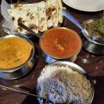 korma chickent, shrimp vindaloo, and lamb saag with fresh garlic nan bread and Indian rice
