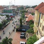 Roof top patio (6th floor) view busy street, can walk or ride tuktuk