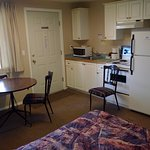 A bachelor suite with full kitchen