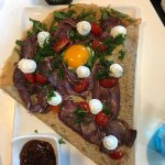 kangaroo prosciutto creamy goat cheese, spinach, egg on a gluten-free crepe