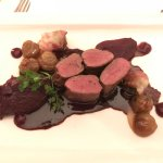 Medallion of venison saddle with red cabbage and brussels sprouts with bacon, pears and chestnut