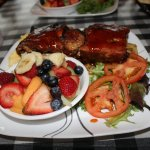 Half rack of ribs with fresh fruit, salad, eggs, homefries & toast (not shown)