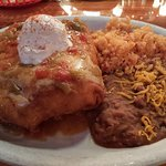 Queso chicken chimichanga with refired beans and rice.