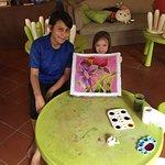 Yuga helping my daughter with Batik painting in Kids Center