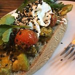 Poached eggs with avocado and roasted tomatoes. Yummy!