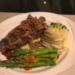 NY Strip steak topped with short ribs meat,garlic mashed potatoes and asparagus.