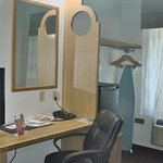 TV, closet, iron, ironing board and desk in room 104 October 2017