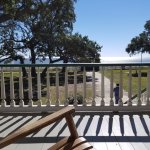 Rock in a rocking chair on the front porch enjoying the gulf view waiting for tour to begin