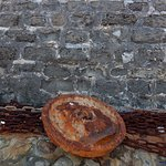 A detail of the wall and metalwork at The Cobb in Lyme Regis.