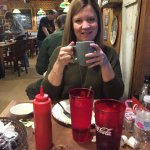 My wife enjoying coffee at the Smokehouse